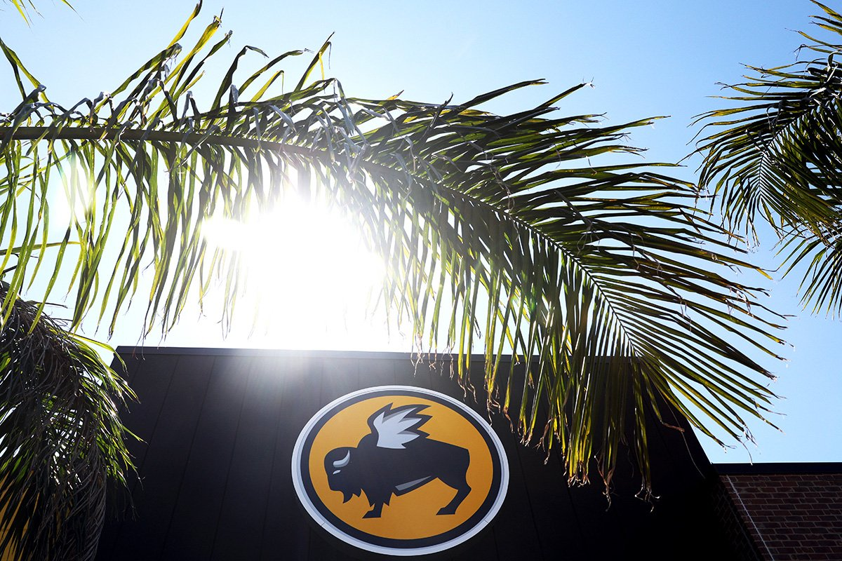 The sign of Buffalo Wild Wings is photographed.